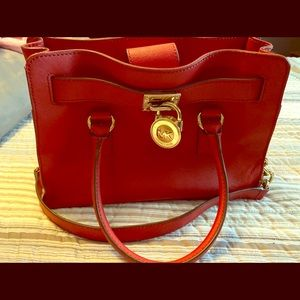 Michael Kors medium red purse, never carried